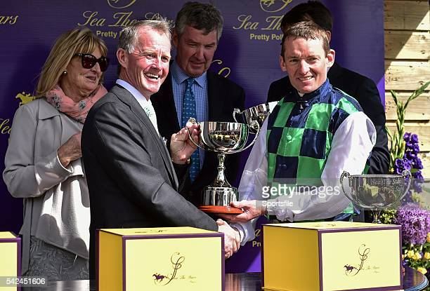 28 June 2015 Former flat racing jockey Mick Kinane awards jockey Seamie Heffernan with the trophy after winning the Sea The Stars Pretty Polly Stakes...