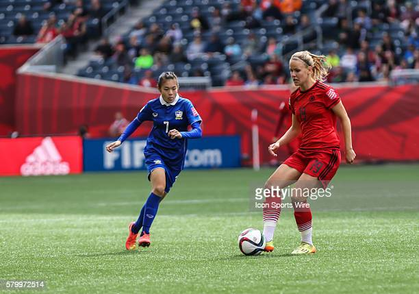 June 2015 Germany's Lena Petermann passes the ball during the Thailand vs Germany game at the Investors Group Field in Winnipeg MB.