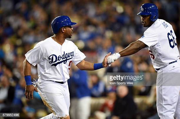 Los Angeles Dodgers Infield Alberto Callaspo [4559] is congratulated by Los Angeles Dodgers Right field Yasiel Puig [9924] after tagging up on a pop...