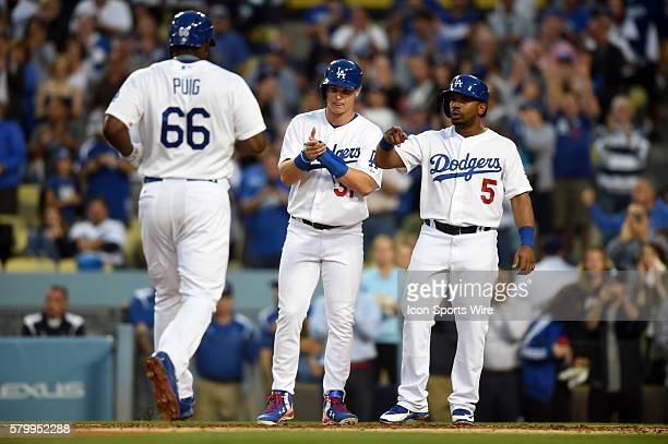 Los Angeles Dodgers Right field Yasiel Puig [9924] is congratulated by his team mates Los Angeles Dodgers Center field Joc Pederson [8776] and Los...