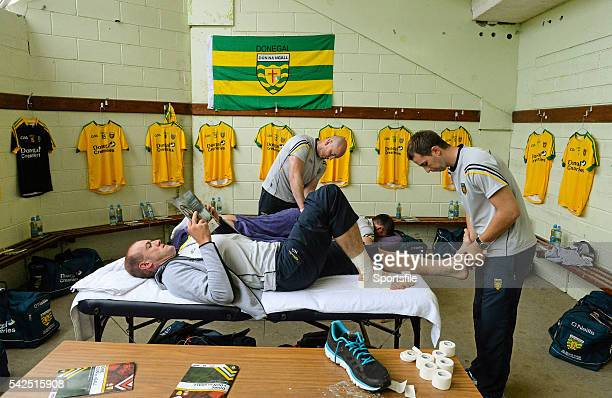 June 2015; Neil Gallagher, Donegal, reading the match programme as he gets some strapping done in the team changing room before the game. Ulster GAA...