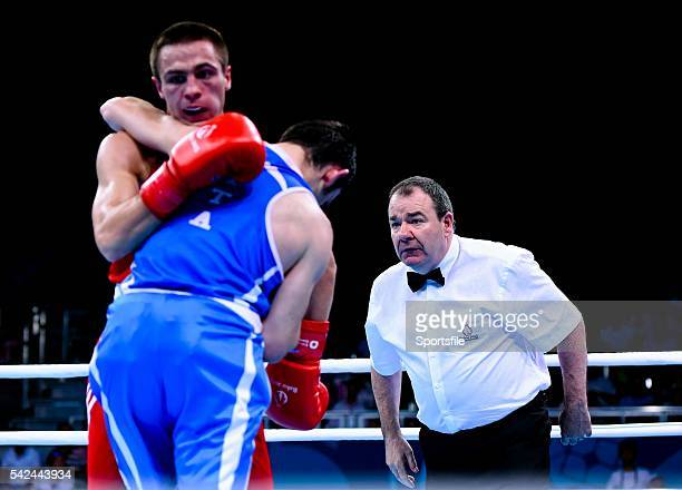 16 June 2015 Referee Micky Gallagher Ireland watches Riccardo D'Andrea Italy and Iurii Shestak Ukriane during their Men's Boxing Bantam 56kg Round of...