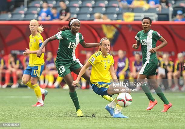 June 2015 Sweden's Kosovare Asllani Nigeria's Ngozi Okobi eye the ball during the Sweden vs Nigeria game at the Investors Group Field in Winnipeg MB.