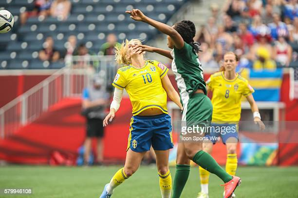 June 2015 Sweden's Sofia Jacobsson battles Nigeria's Onome Ebi during the Sweden vs Nigeria game at the Investors Group Field in Winnipeg MB.