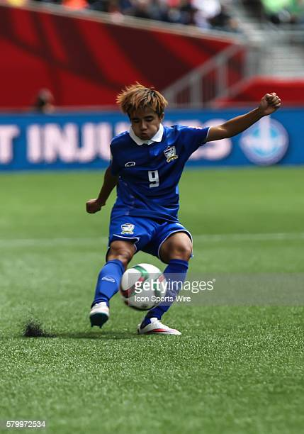June 2015 Thailand's Warunee Phetwiset makes a pass during the Thailand vs Germany game at the Investors Group Field in Winnipeg MB.
