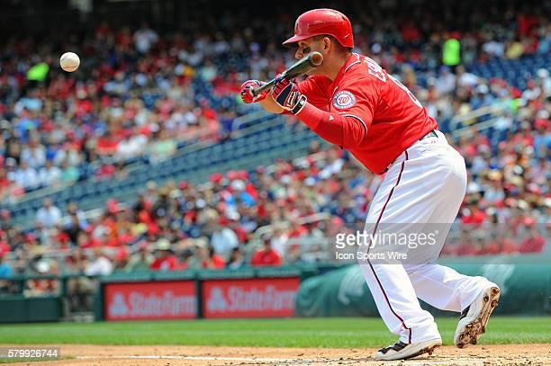 Washington Nationals second baseman Danny Espinosa hits a bunt at Nationals Park in Washington DC where the Chicago Cubs defeated the Washington...