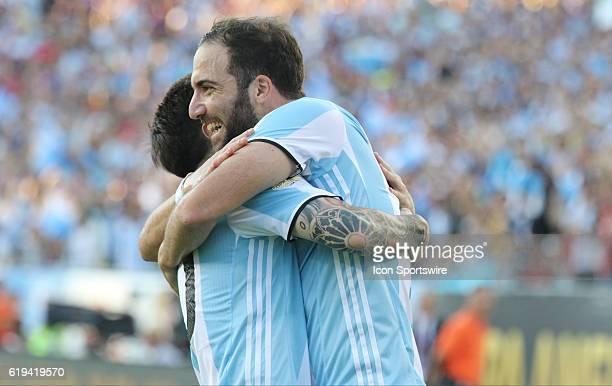 Argentina forward Gonzalo Higuain hugs Argentina forward Lionel Messi after Gonzalo scores a goal Saturday Argentina defeated Venezuela 41 in the...