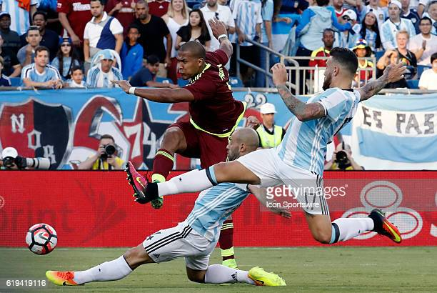 Argentina midfielder Javier Mascherano and Argentina defender Nicolas Otamendi can not stop the shot from Venezuela forward Salomon Rondon Argentina...