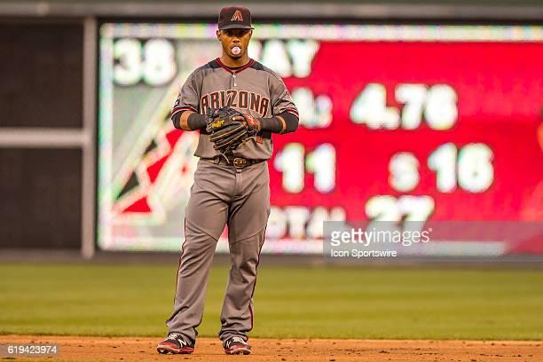 Arizona Diamondbacks second baseman Jean Segura blows bubbles while he waits for play to resume during the Major League Baseball game between The...