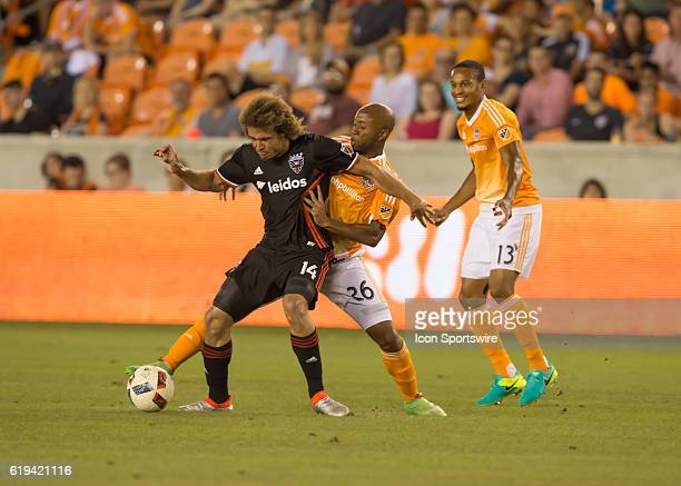 DC United midfielder Nick DeLeon and Houston Dynamo midfielder Collen Warner fight for ball during the MLS soccer match between DC United and Houston...