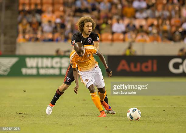 Houston Dynamo midfielder DaMarcus Beasley and DC United midfielder Nick DeLeon fight for ball during the MLS soccer match between DC United and...