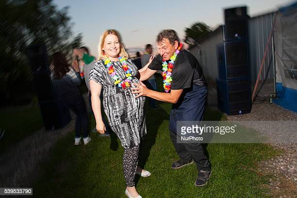 June 2016 People are seen at an evening a week ahead of the wedding where guests are invited to throw butelki empty bottles Polterabend is a...