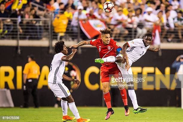 Peru forward Andy Polo and Colombia defender Cristian Zapata fight for a header in the second half during the Copa America Centenario quarterfinal...