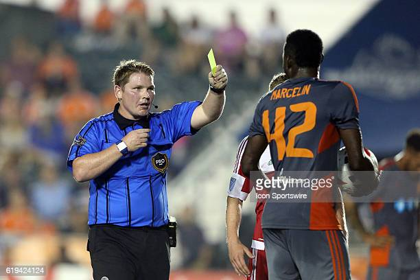 Referee Kevin Terry Jr shows the yellow card to Carolina's James Marcelin The Carolina RailHawks hosted the New England Revolution at WakeMed Stadium...