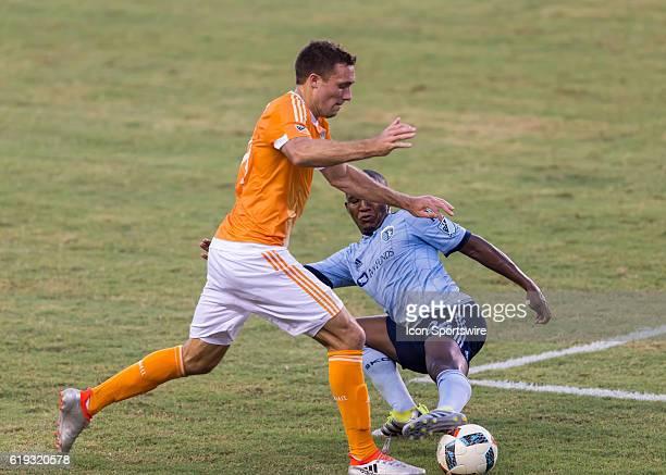 Sporting Kansas City midfielder Jimmy Medranda slide tackles Houston Dynamo forward Andrew Wenger during the Lamar Hunt US Open Cup soccer match...
