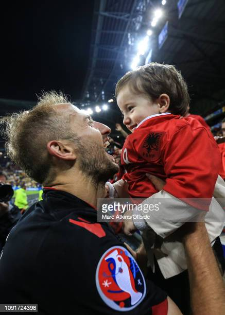 June 2016 - UEFA EURO 2016 - Group A - Romania v Albania - Migjen Basha of Albania celebrates the win with his child - .