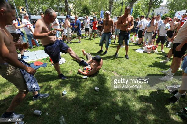 June 2016 - UEFA EURO 2016 - Group B - Slovakia v England - Bare chested England fans play football in the main square in Saint-Etienne -