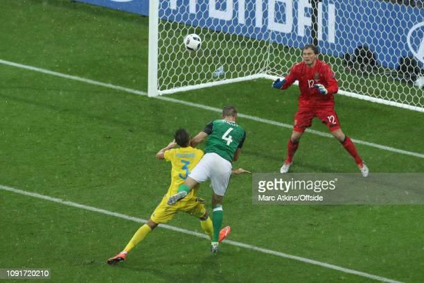 16 June 2016 UEFA EURO 2016 Group C Ukraine v Northern Ireland Gareth McAuley of Northern Ireland scores the opening goal