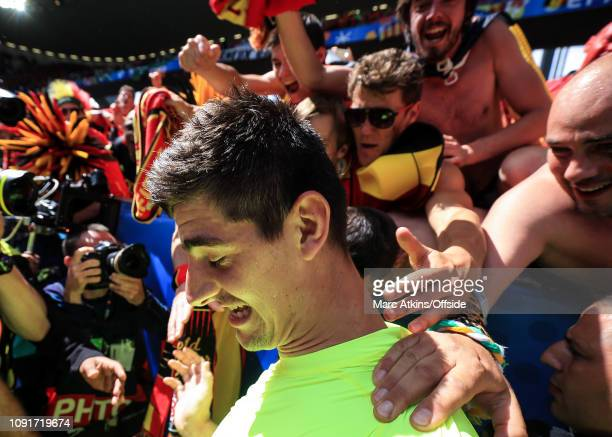 18 June 2016 UEFA EURO 2016 Group E Belgium v Republic of Ireland Belgium goalkeeper Thibaut Courtois is mobbed by fans after handing them his shirt
