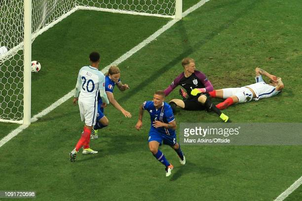 27 June 2016 UEFA EURO 2016 Round of 16 England v Iceland Dejected England players as Ragnar Sigurdsson of Iceland celebrates scoring the equaling...