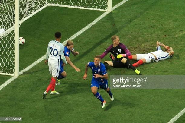 27 June 2016 UEFA EURO 2016 Round of 16 England v Iceland Dejected England players as Ragnar Sigurdsson of Iceland celebrates scoring the equaling...