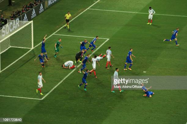 June 2016 - UEFA EURO 2016 - Round of 16 - England v Iceland - Iceland celebrate the win as England players slump to the pitch - .