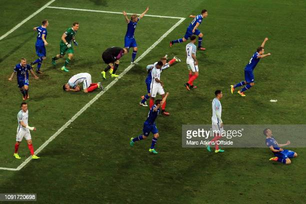 27 June 2016 UEFA EURO 2016 Round of 16 England v Iceland Iceland celebrate the win as England players slump to the pitch