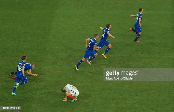 June 2016 - UEFA EURO 2016 - Round of 16 - England v Iceland - Jack Wilshere of England slumps to the floor as Iceland players celebrate - .