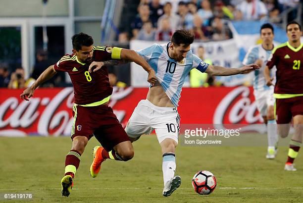 Venezuela midfielder Tomas Rincon tries to slow down Argentina forward Lionel Messi Argentina defeated Venezuela 41 in the quarterfinal of the 2016...