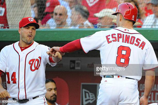 Washington Nationals shortstop Danny Espinosa is congratulated by center fielder Chris Heisey after scoring against the Chicago Cubs at Nationals...