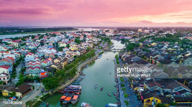 june 2017 hoi an, vietnam - the main river thoroughfare on the thu bon river in hoi an at sunset. - hoi an stock pictures, royalty-free photos & images