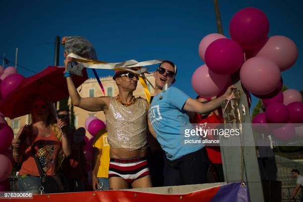 Participants of the Gay Pride Parade pose with balloons Thousands partook in the Gay Pride Parade 2018 in front of the greek parliament in Athens...