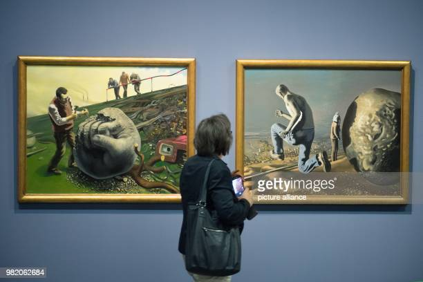 A woman looks at the paintings Sisyphos behaut den Stein and Die Flucht des Sisyphos both by Wolfgang Mattheuer shown at the Albertinum where the...