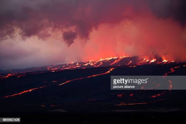Lava runs down the slope after the eruption of volcano Sierra Negra Firemen have been in action on the Island Isabela since the 27 June The crater of...