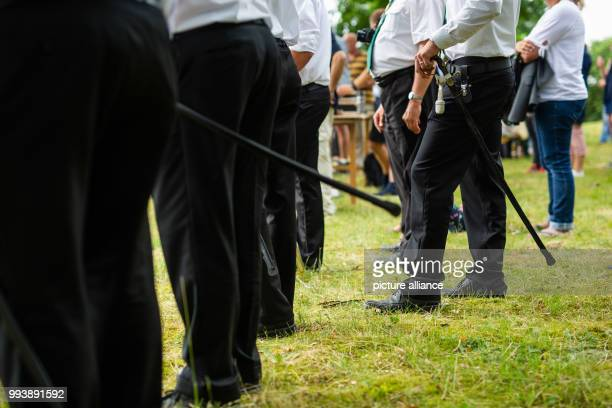 Saberwearing members of the shooting club photographed during the proclamation of the marksmen of the shooting competition in Garßen near Celle Photo...
