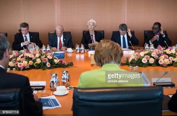 German Chancellor Angela Merkel of the Christian Democratic Union and the chairmen of international finance and economy organisations Guy Ryder...