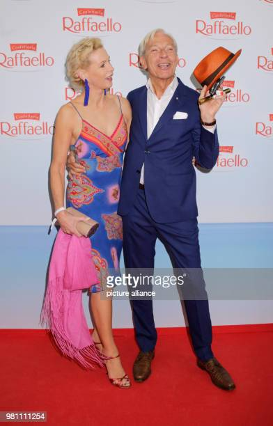 """June 2018, Germany, Berlin: Jo Groebel, media scientist, and wife Grit Weiss arriving to the """"Raffaello Summer Day"""" in support of the Arche..."""