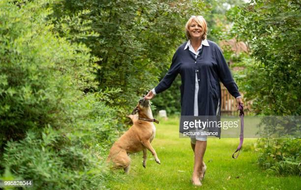 The presenter Alida Gundlach plays with her dog in the garden Gundlach celebrates her 75th birthday on 17 July Photo Philipp Schulze/dpa