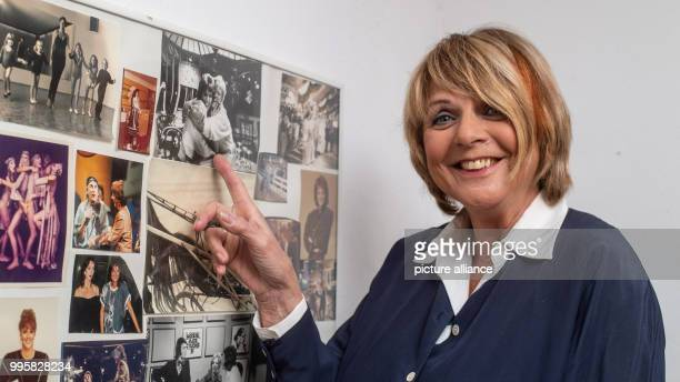 The presenter Alida Gundlach points at a picture of her and Klaus Kinski Gundlach celebrates her 75th birthday on 17 July Photo Philipp Schulze/dpa