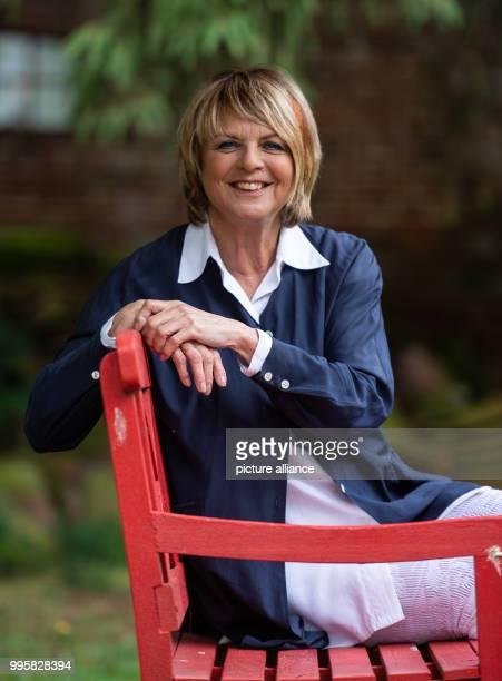 The presenter Alida Gundlach sits on a bench in her garden Gundlach celebrates her 75th birthday on 17 July Photo Philipp Schulze/dpa
