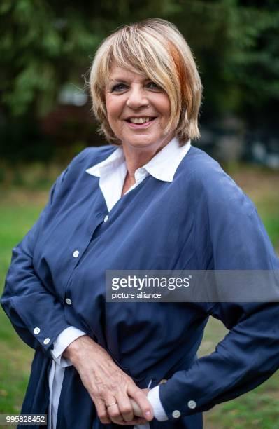 The presenter Alida Gundlach stands in her garden Gundlach celebrates her 75th birthday on 17 July Photo Philipp Schulze/dpa