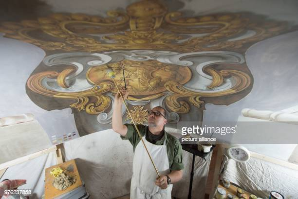 Church painter Andre Voltere working in the Castle's chapelA briefing on the construction work in the parade halls in the Castle's West Wing and in...