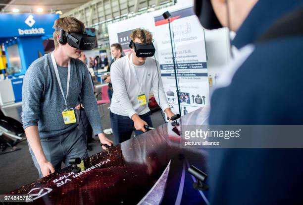 Visitors at a stand from Virtual Industries wearing VRglasses and playing foosball at the digitalisation fair Cebit After three decades Cebit is...