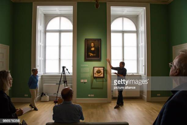 View into the painting room in the Munich Residenz with a copy of the Mona Lisa painting by a window The reopening of the Koenigsbau of the Munich...