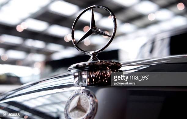 A Mercedes star on a vintage car at a car dealership The compulsory recall for hundreds of thousands Daimler diesel vehicles is a further chapter in...