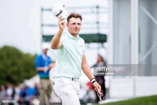 24 June 2018 Germany Pulheim Golf Europe Tour International Open Singles Men 4th Round English golfer Matt Wallace waving to spectators with his cap...