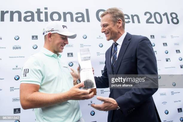 Golf European Tour International Open mens singles 4th round The winner Matt Wallace a golfer from England being awarded the trophy by BMW's...