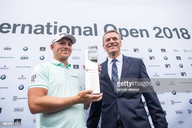 Golf European Tour International Open mens singles 4th round The winner Matt Wallace a golfer from England presenting his trophy Next to him is BMW's...