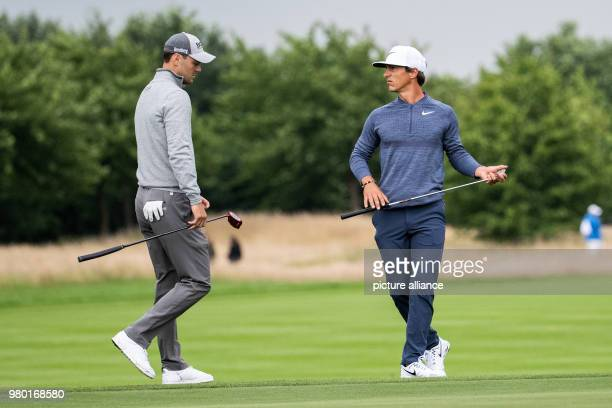 June 2018, Germany, Pulheim: Golf, European Tour - International Open. Danish golfer Thorbjørn Olesen and German golder Martin Kaymer walking over...