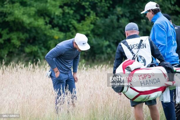 June 2018, Germany, Pulheim: Golf, European Tour - International Open. Danish golfer Thorbjørn Olesen looking for his ball. Photo: Marcel Kusch/dpa